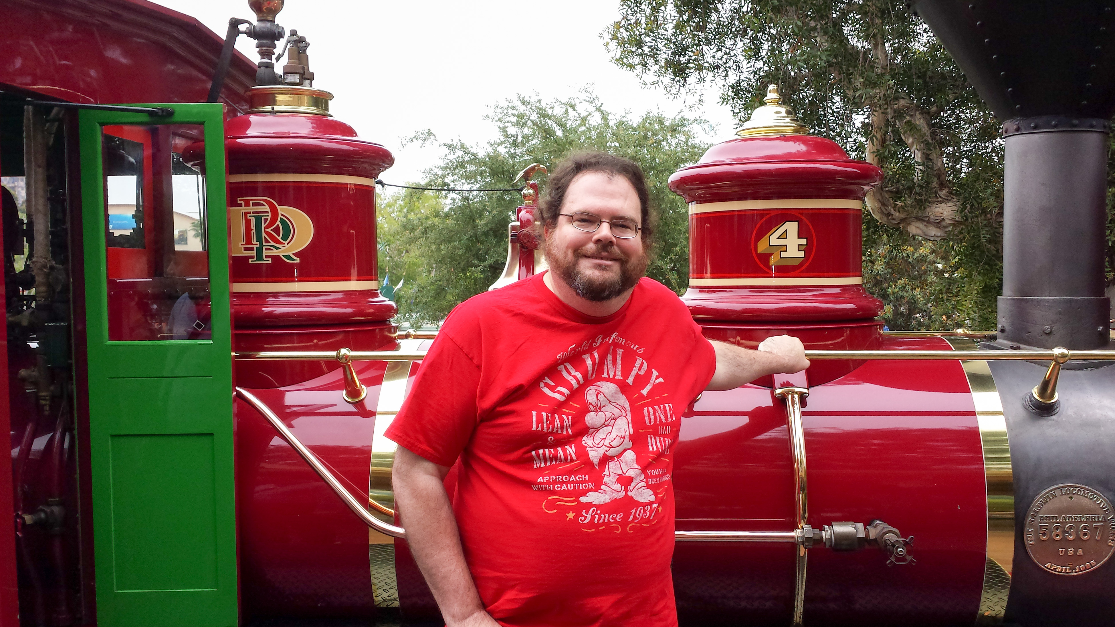 Patrick with Disneyland Railroad locomotive 4, Ernest S. Marsh